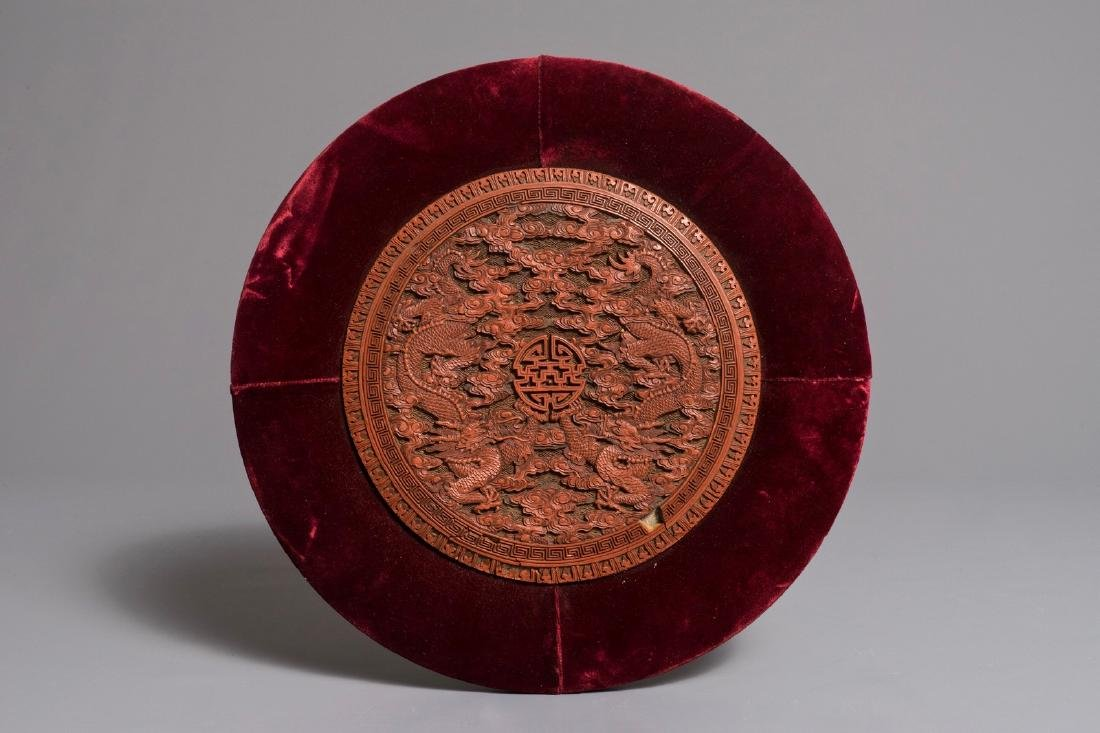 A round Chinese cinnabar lacquer plaque with two