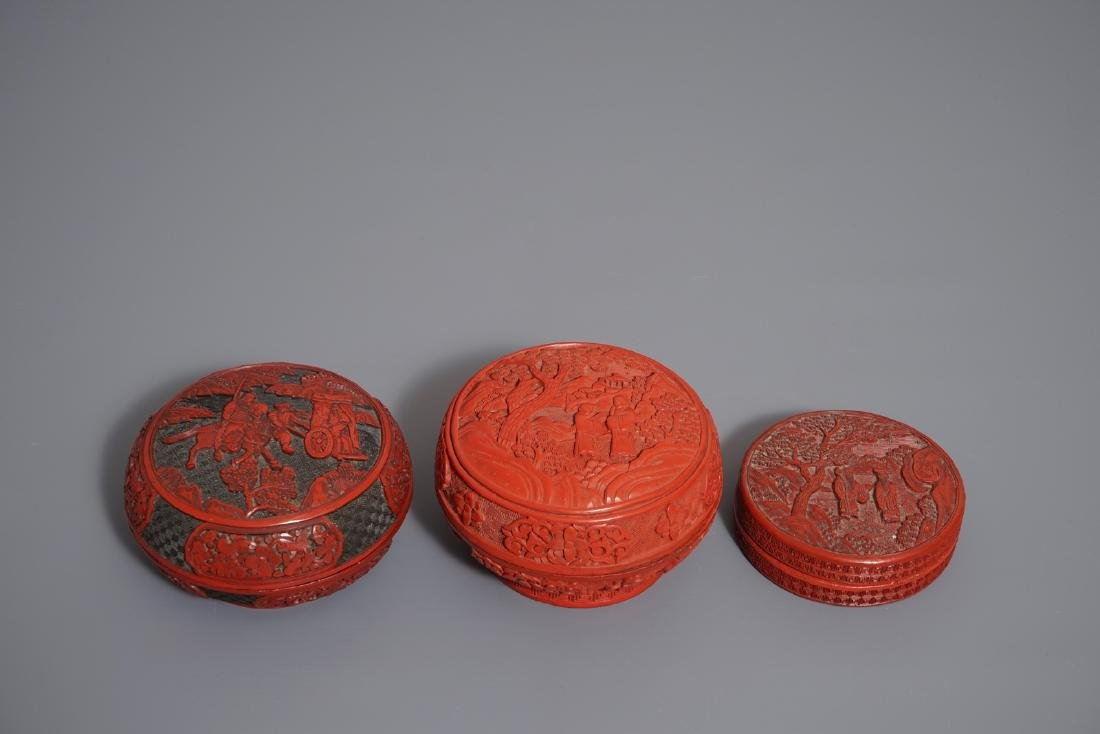 Three round Chinese cinnabar lacquer covered boxes with