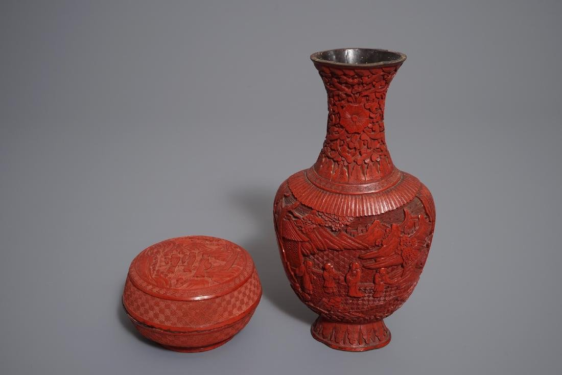 A Chinese cinnabar lacquer vase and a round box and