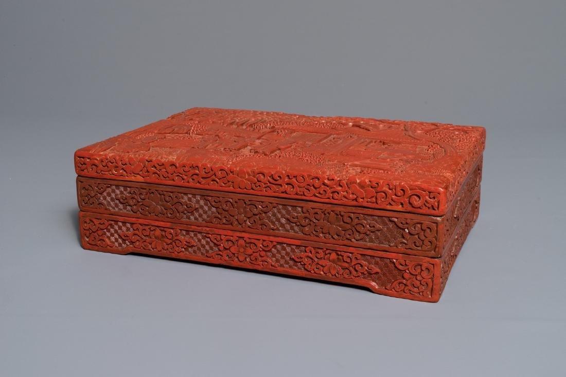A rectangular Chinese cinnabar lacquer three-tier box