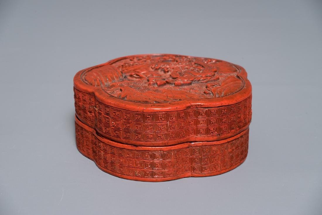 A Chinese flower-shaped cinnabar lacquer box with
