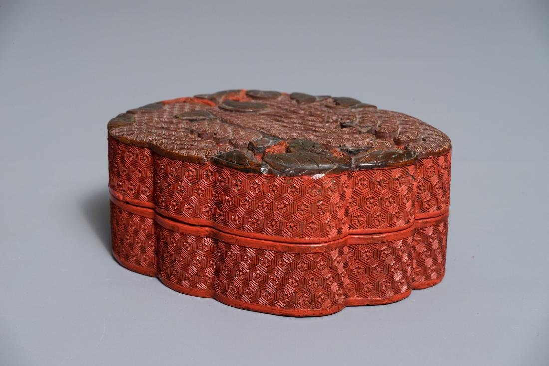 A Chinese polychrome lacquer box in the shape of a