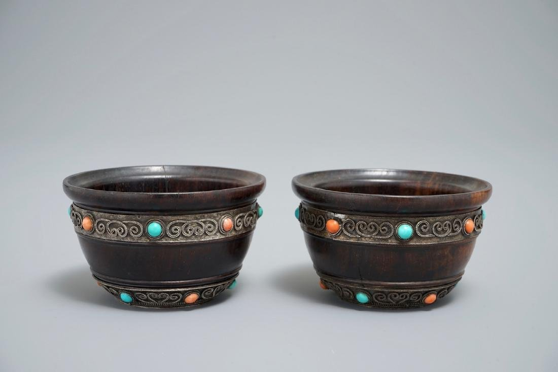 A pair of Tibetan wooden cups with turquoise- and