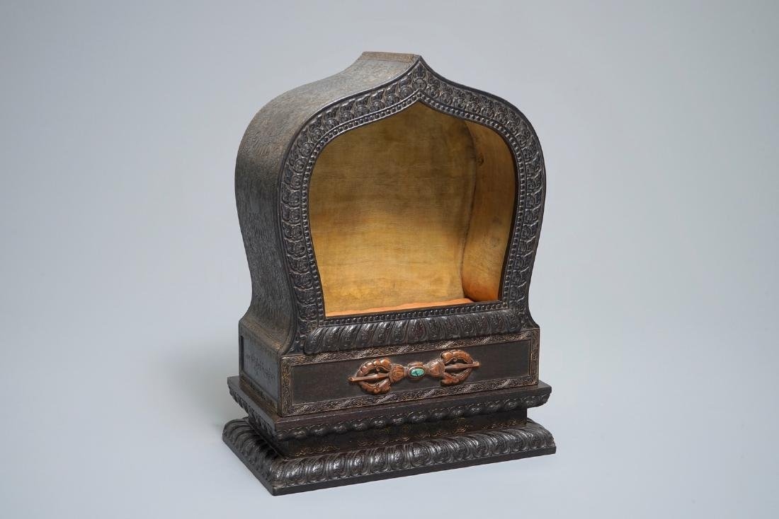A Chinese inlaid carved wood shrine with inscription,