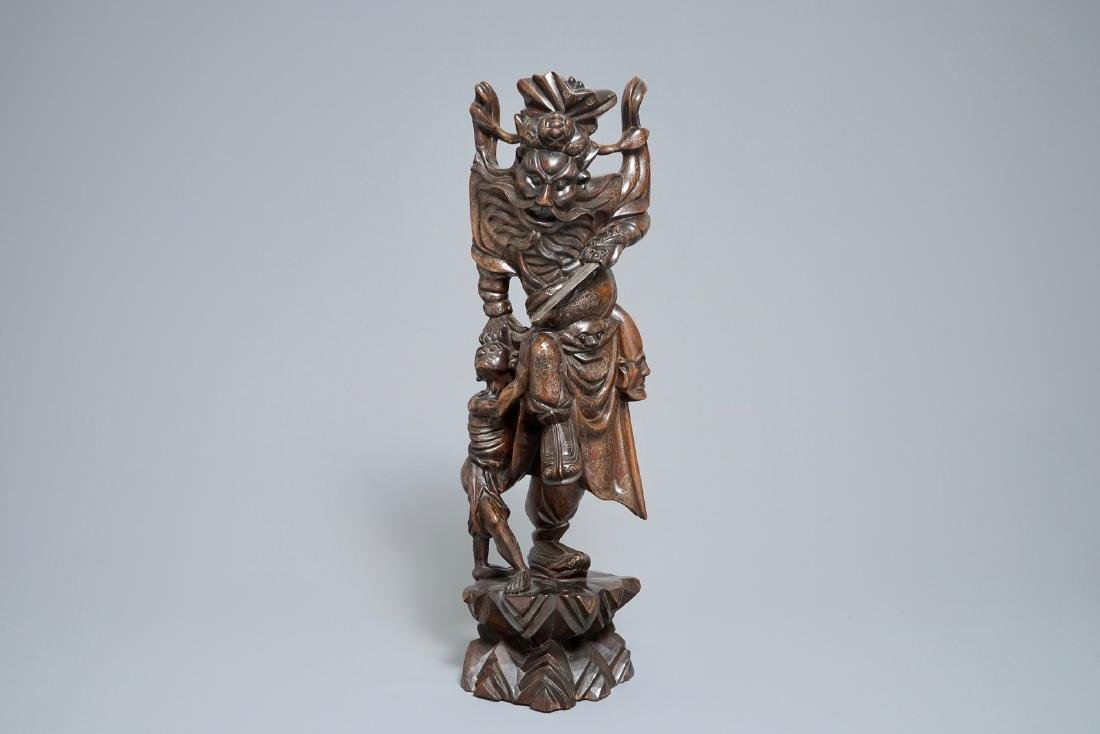 A tall Chinese silver-inlaid wooden figure of Zhong