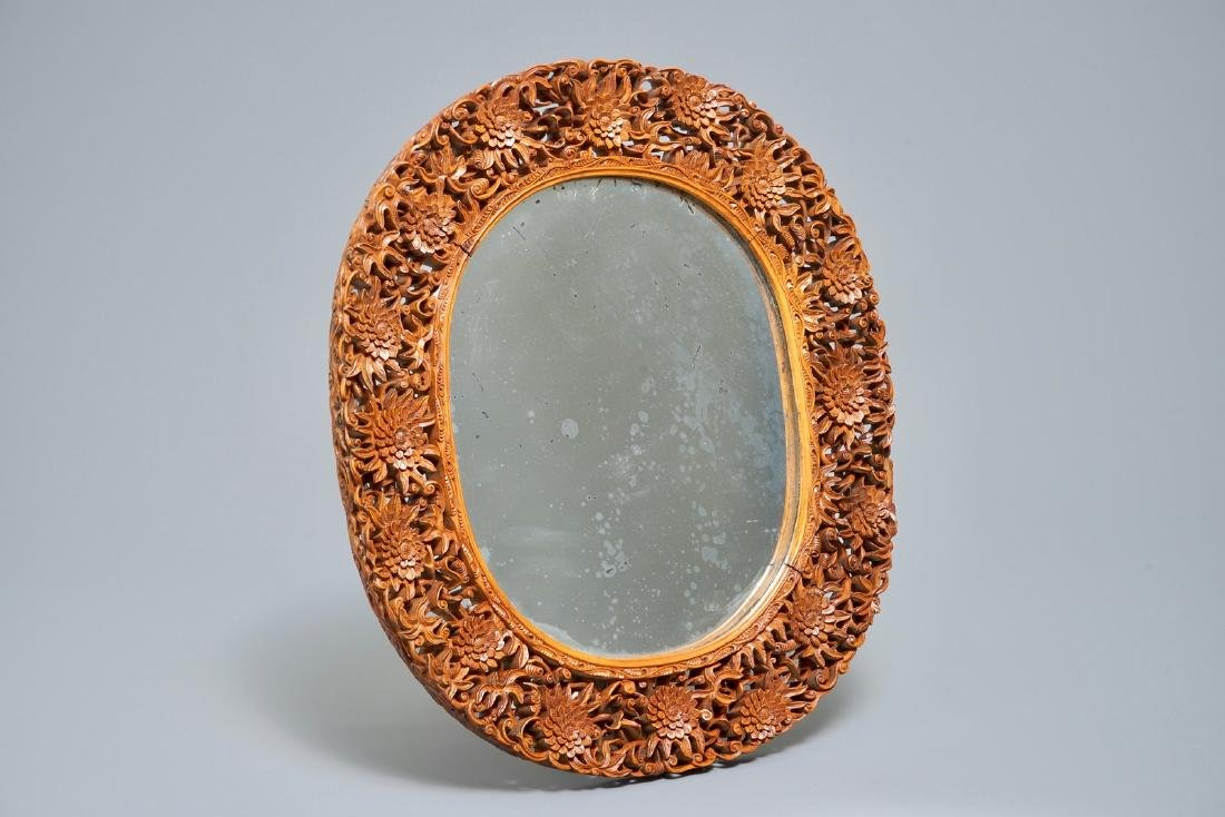 A finely carved Chinese wooden mirror frame, Canton,