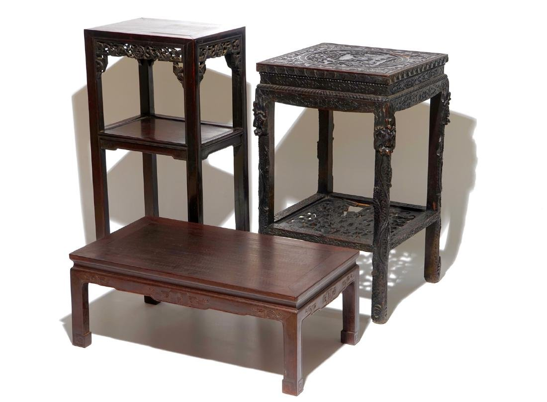 Two Chinese carved wood stands and a low table, 19th C.