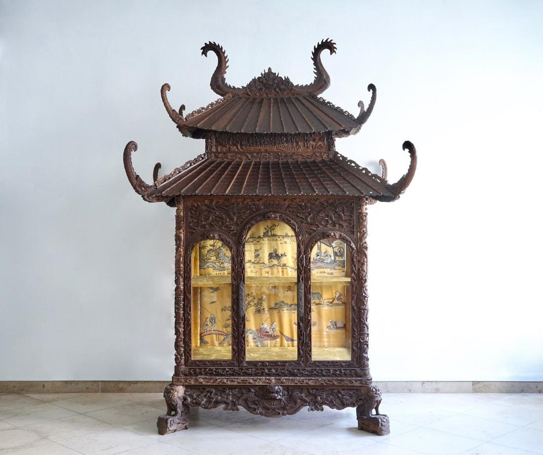 A richly carved Chinese pagoda-shaped display case, ca.