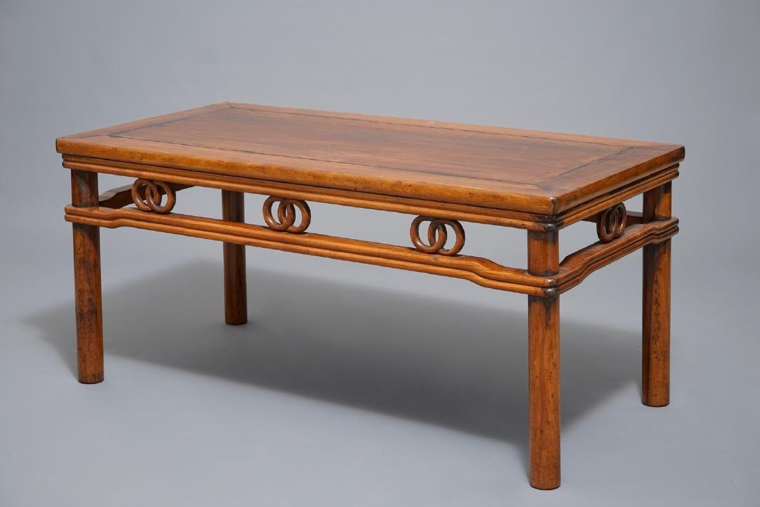A Chinese wooden rectangular low table, 19th C.