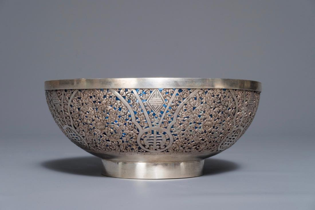 A Chinese reticulated silver bowl with blue glass