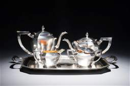 A Chinese silver art deco tea service on tray,