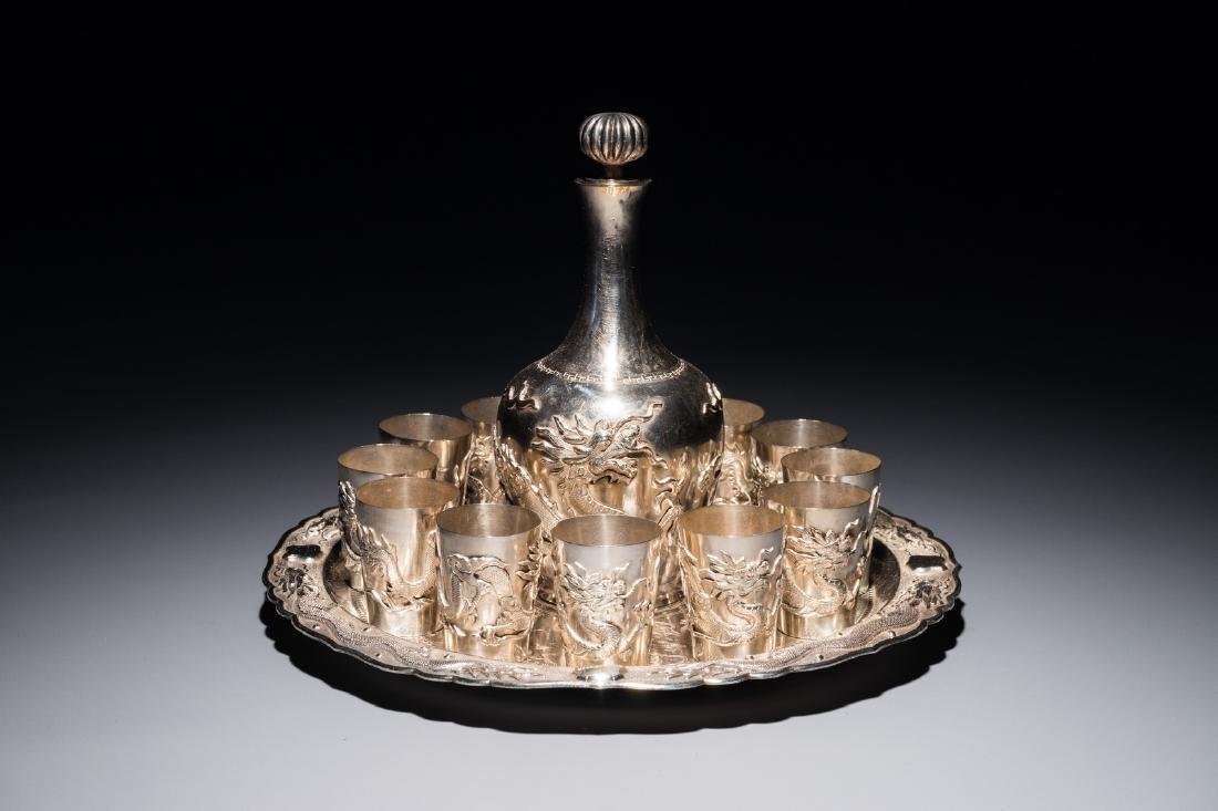 A Chinese silver liquor set on tray with applied dragon