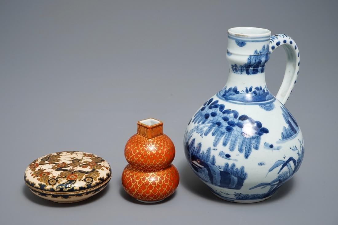 A Japanese blue and white Arita jug, Edo, 17th C., a