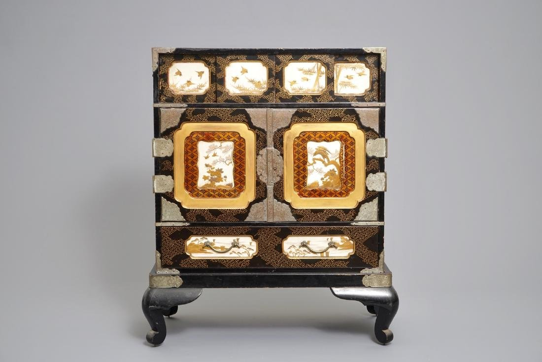 A Japanese gilt-lacquered and Shibayama   cabinet,