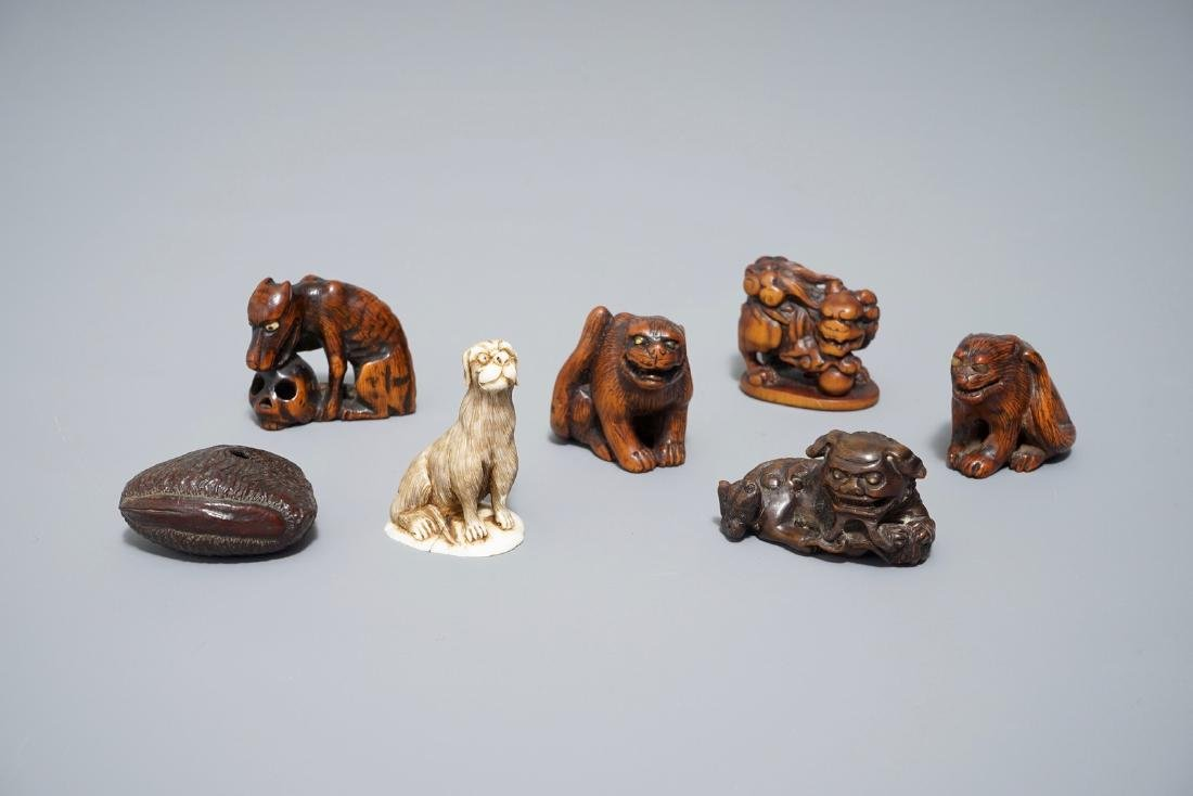 Seven Japanese carved wood and   netsuke and okimono,