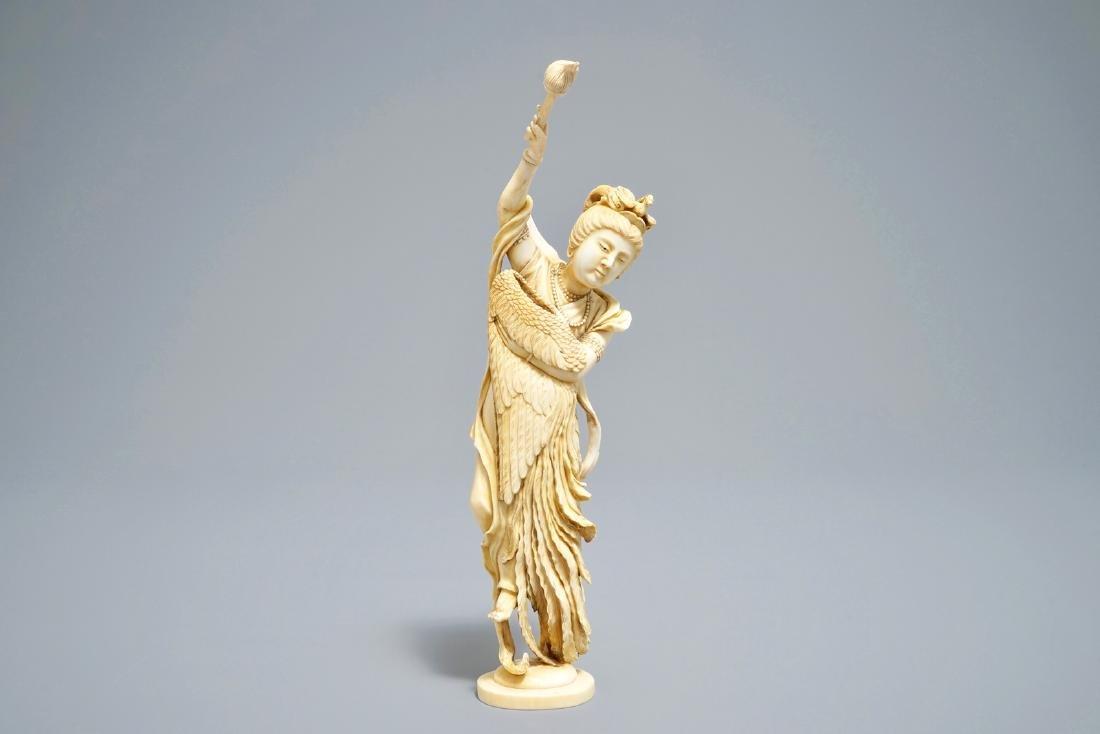 A Japanese   okimono of the goddess Kannon holding a