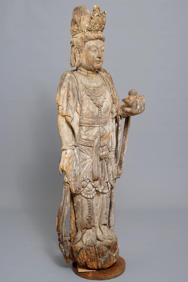 A tall Chinese carved wood figure of Guanyin, Ming