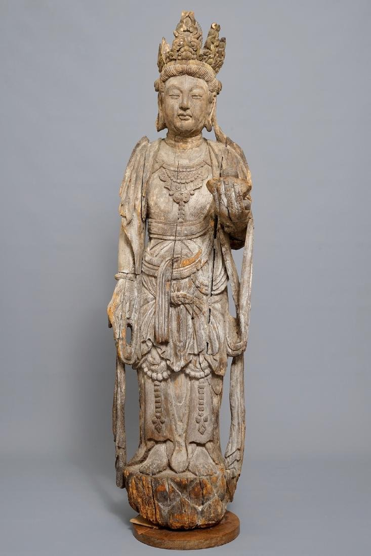 A tall Chinese carved wood figure of Guanyin, Ming - 2