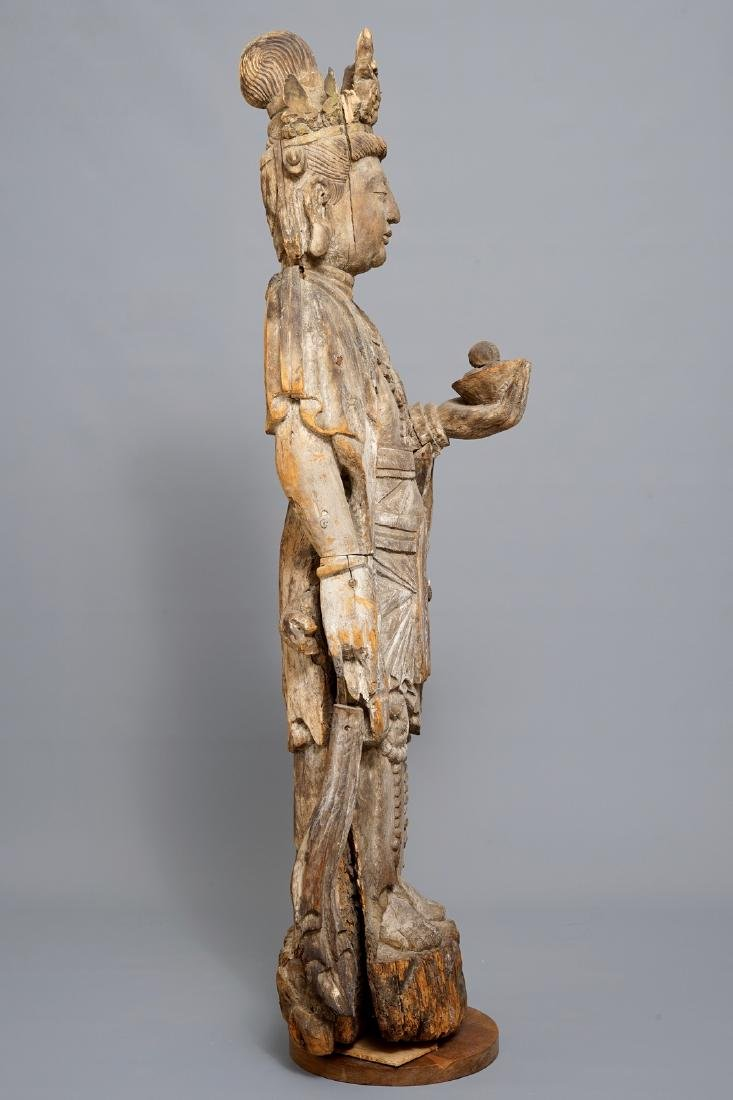 A tall Chinese carved wood figure of Guanyin, Ming - 3