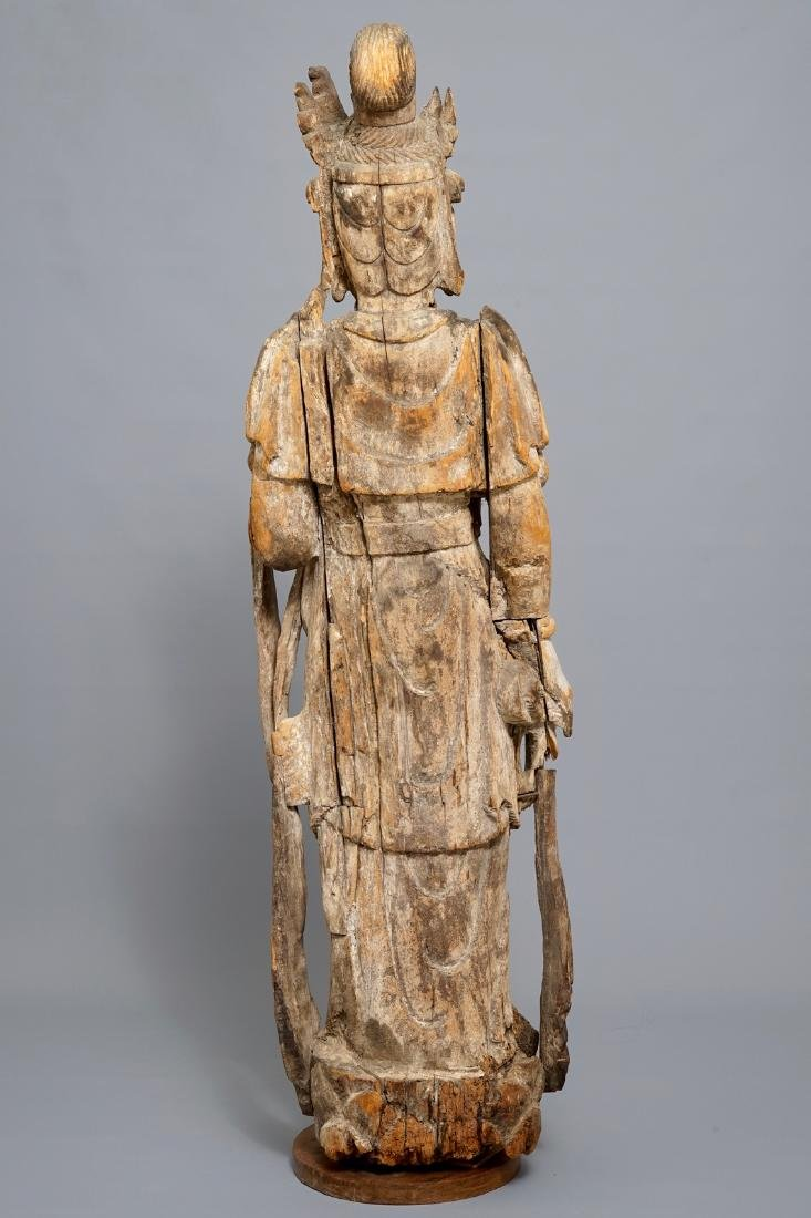 A tall Chinese carved wood figure of Guanyin, Ming - 4