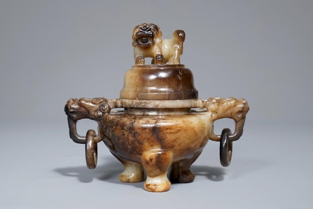 A Chinese mottled jade tripod incense burner and cover,