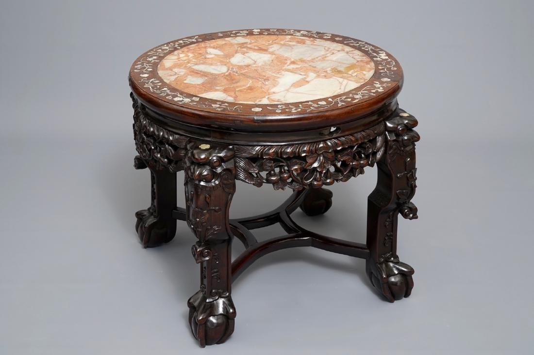 A Chinese wooden stand with marble top and mother of