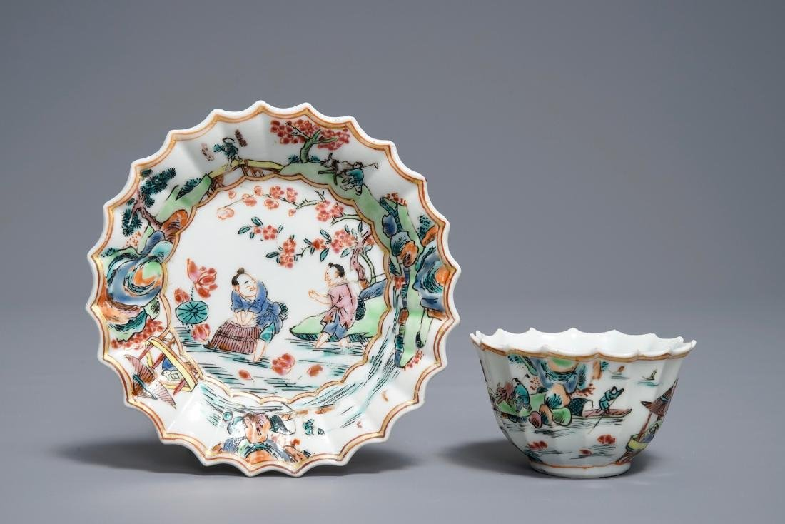 A Chinese famille rose cup and saucer with fishermen,
