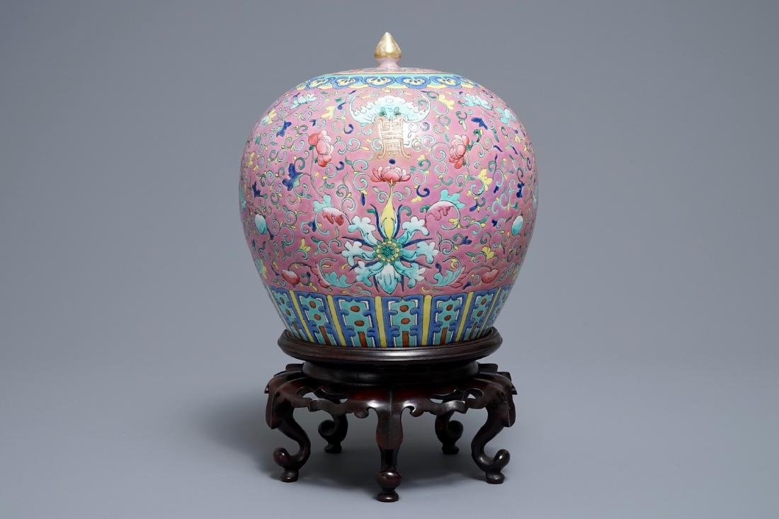 A Chinese famille rose jar and cover on wooden stand,
