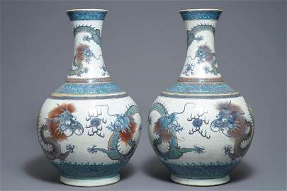 A pair of large Chinese doucai 'dragon' bottle vases,