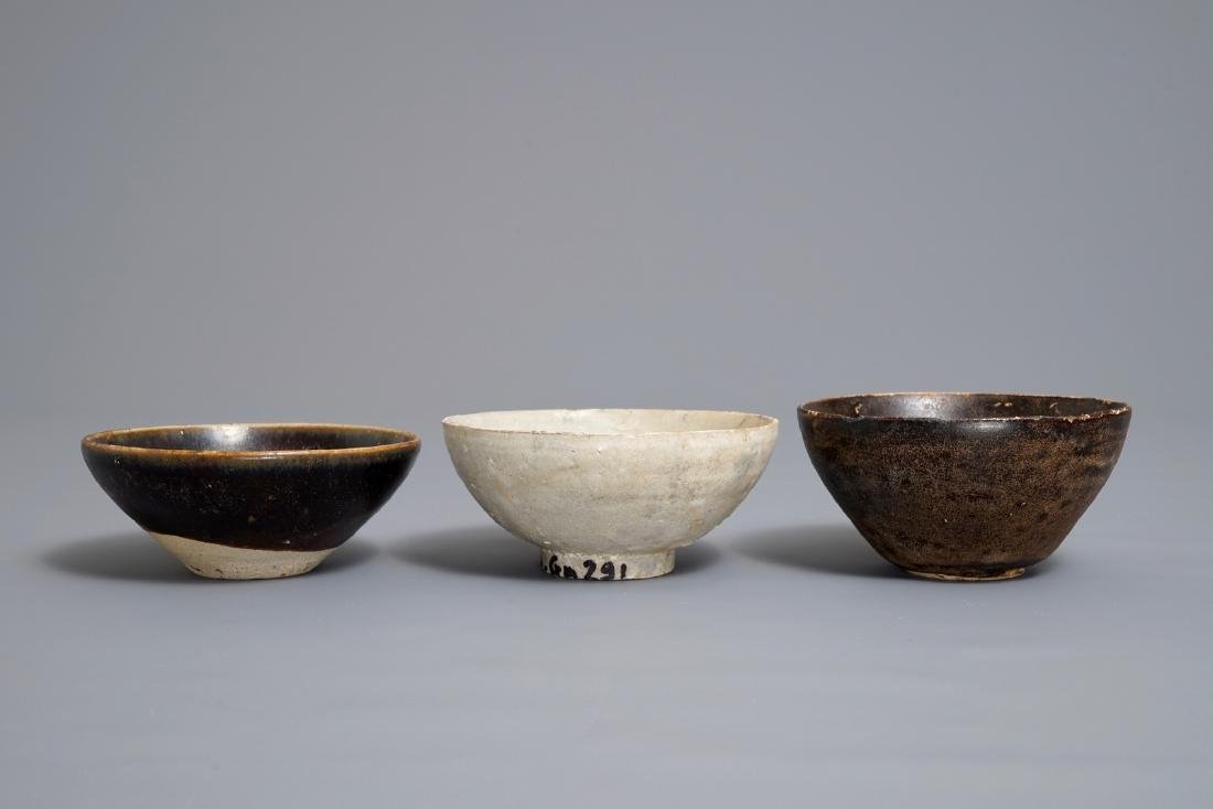 Three Chinese black-, brown- and cream-glazed bowls,