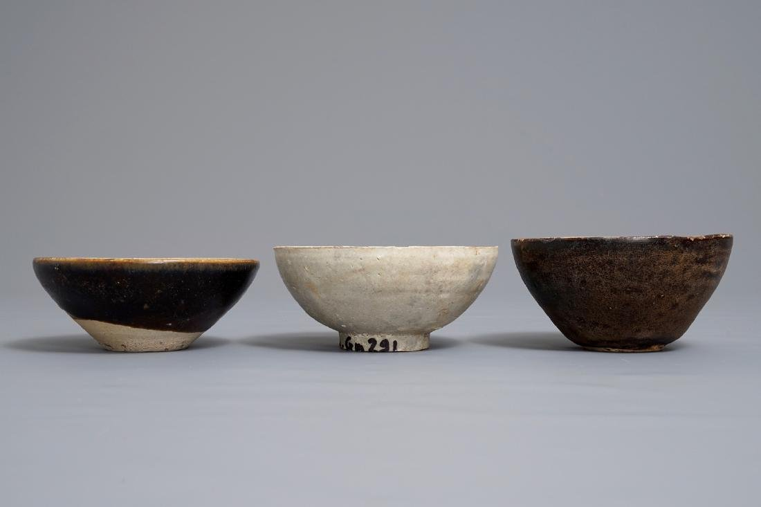 Three Chinese black-, brown- and cream-glazed bowls, - 2