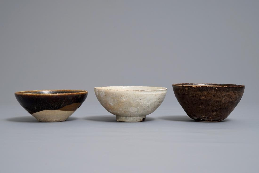 Three Chinese black-, brown- and cream-glazed bowls, - 4