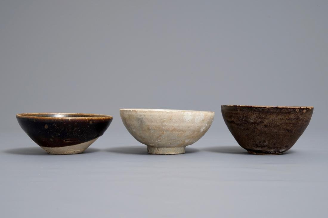 Three Chinese black-, brown- and cream-glazed bowls, - 5