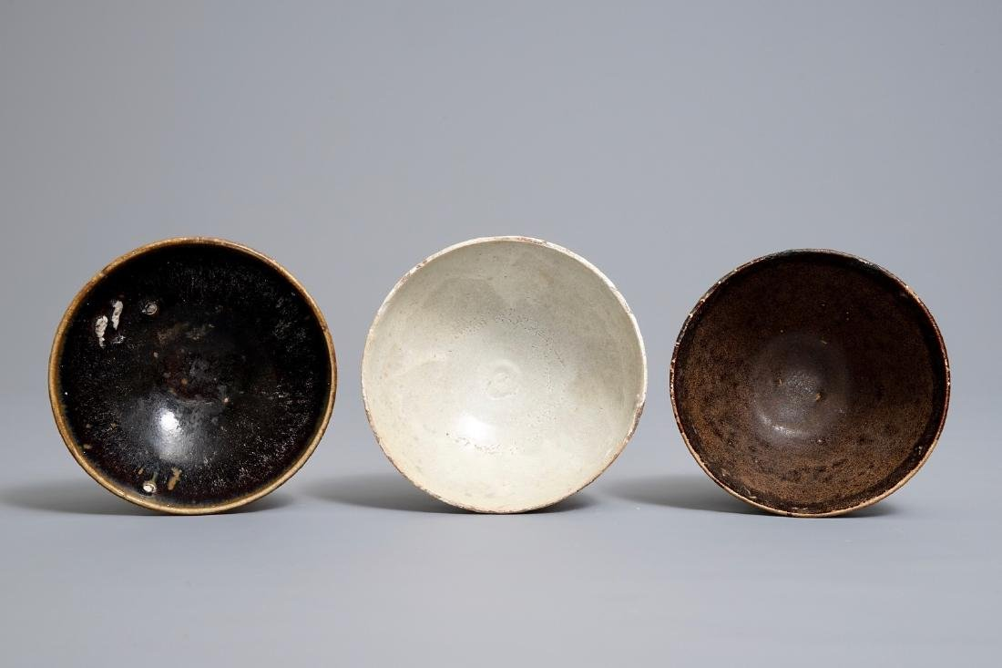 Three Chinese black-, brown- and cream-glazed bowls, - 6