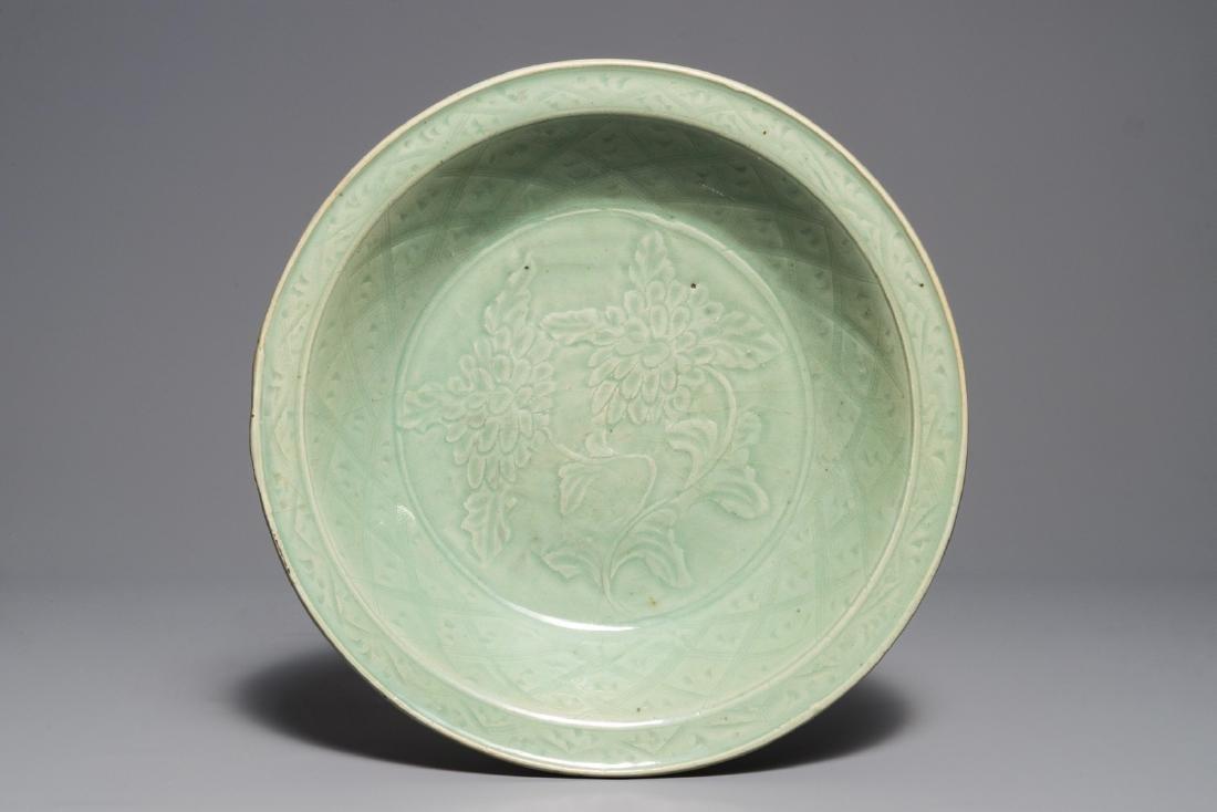 A Chinese Longquan celadon dish with underglaze design