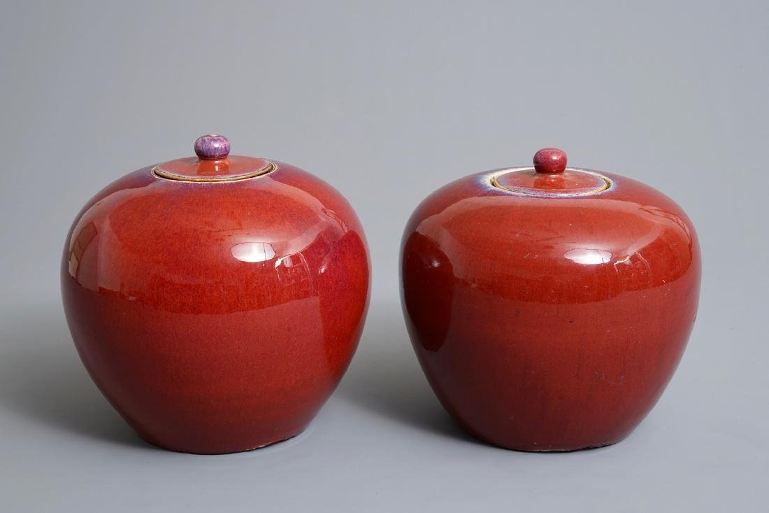 A pair of Chinese monochrome oxblood-glazed jars and
