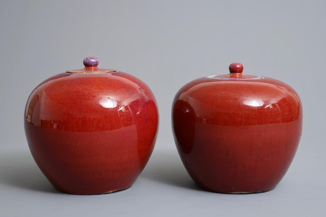 A pair of Chinese monochrome oxblood-glazed jars and - 2