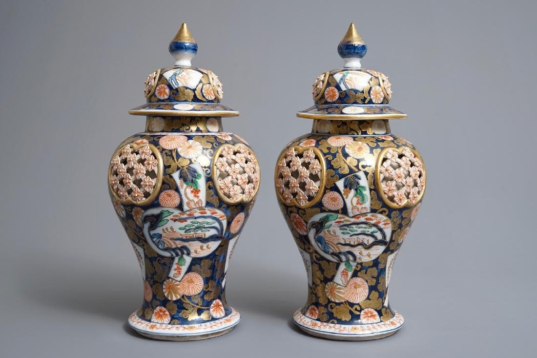 A pair of Imari-style double-walled reticulated vases