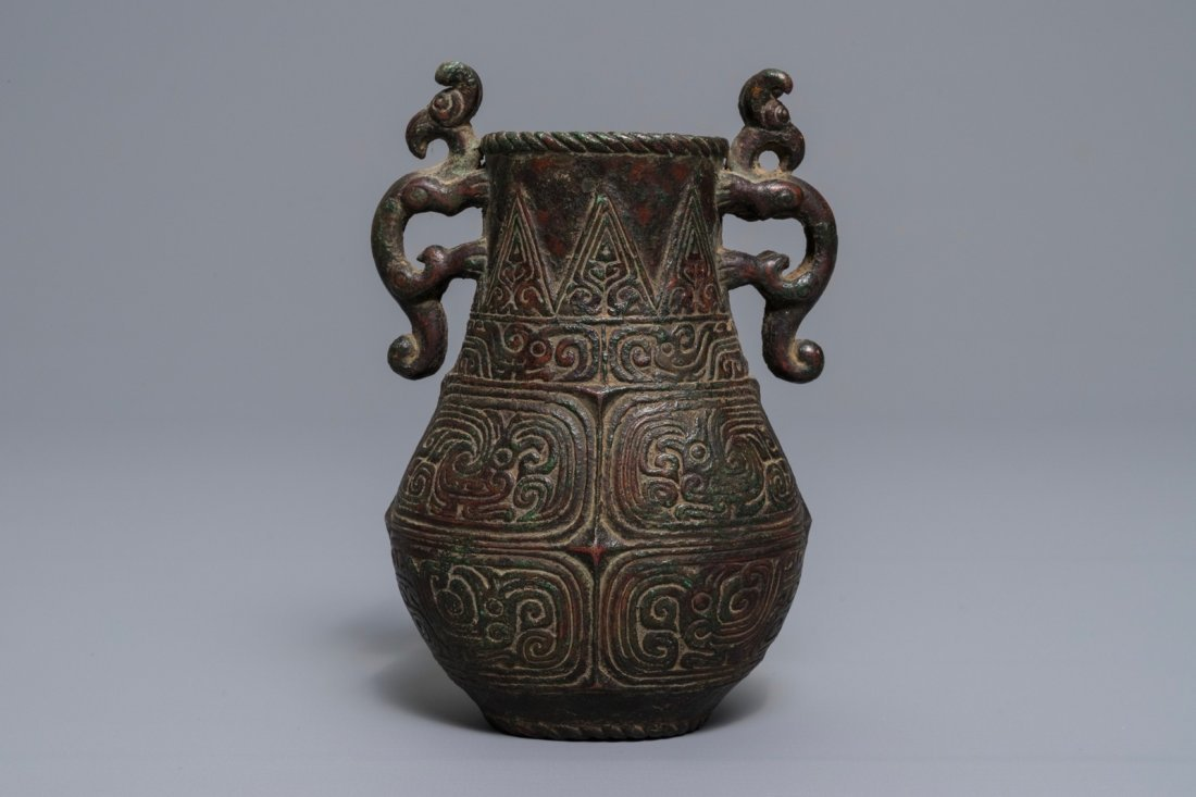 An archaic Chinese relief-decorated two-handled bronze