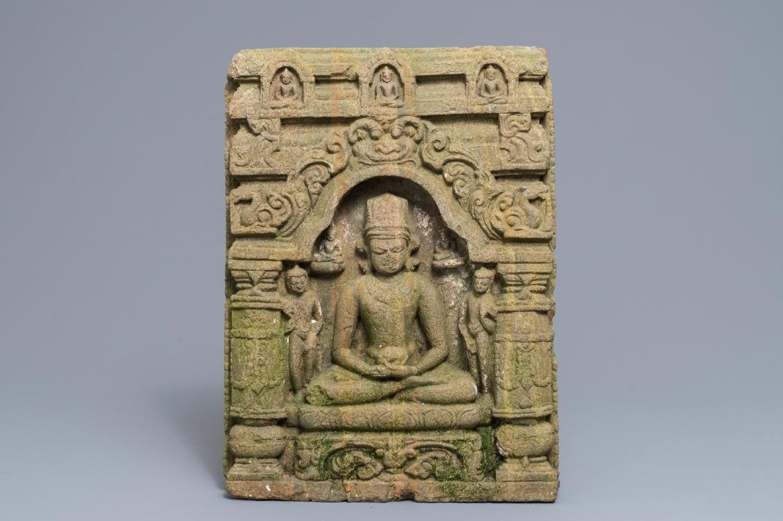 Indian sandstone relief: Buddha seated in temple, India
