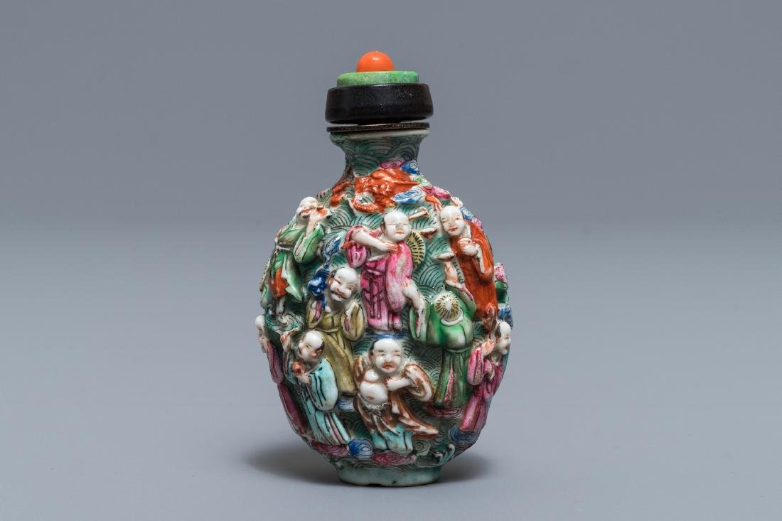 A Chinese famille rose relief-decorated snuff bottle,