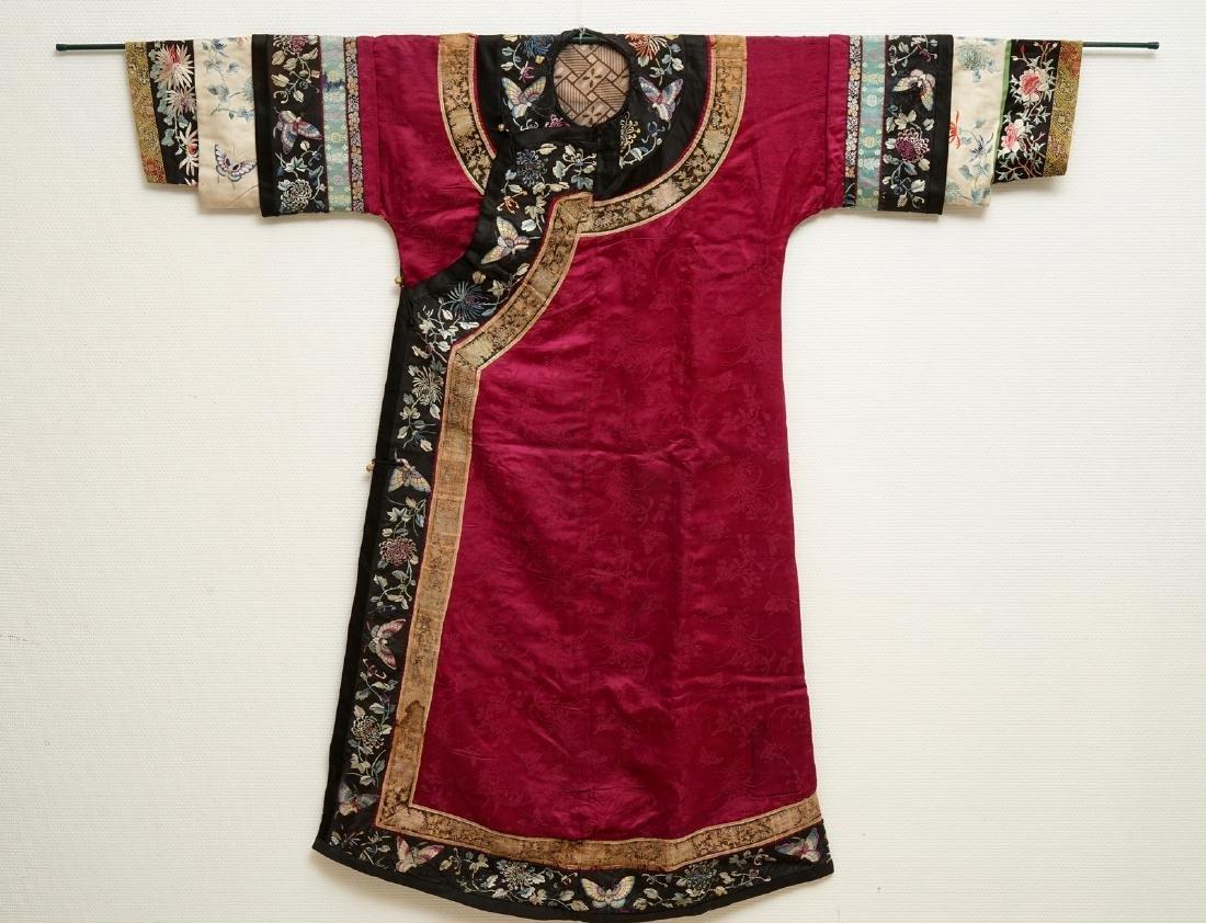 A Chinese informal Manchu embroidered silk pink-ground