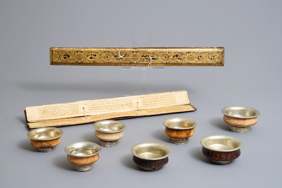Seven burl wood and silver teabowls and two gilt wood