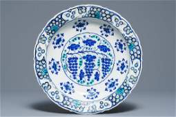An Iznik 'grapevine' dish in blue and green, Turkey,