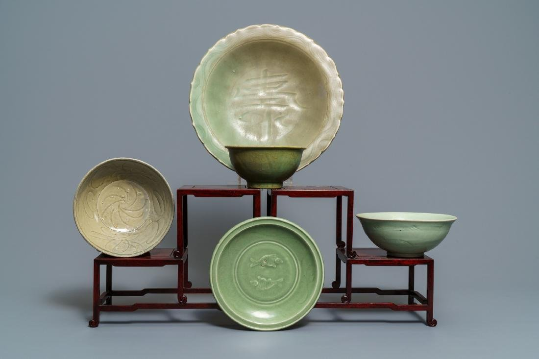 Two Chinese Longquan celadon dishes and three bowls,