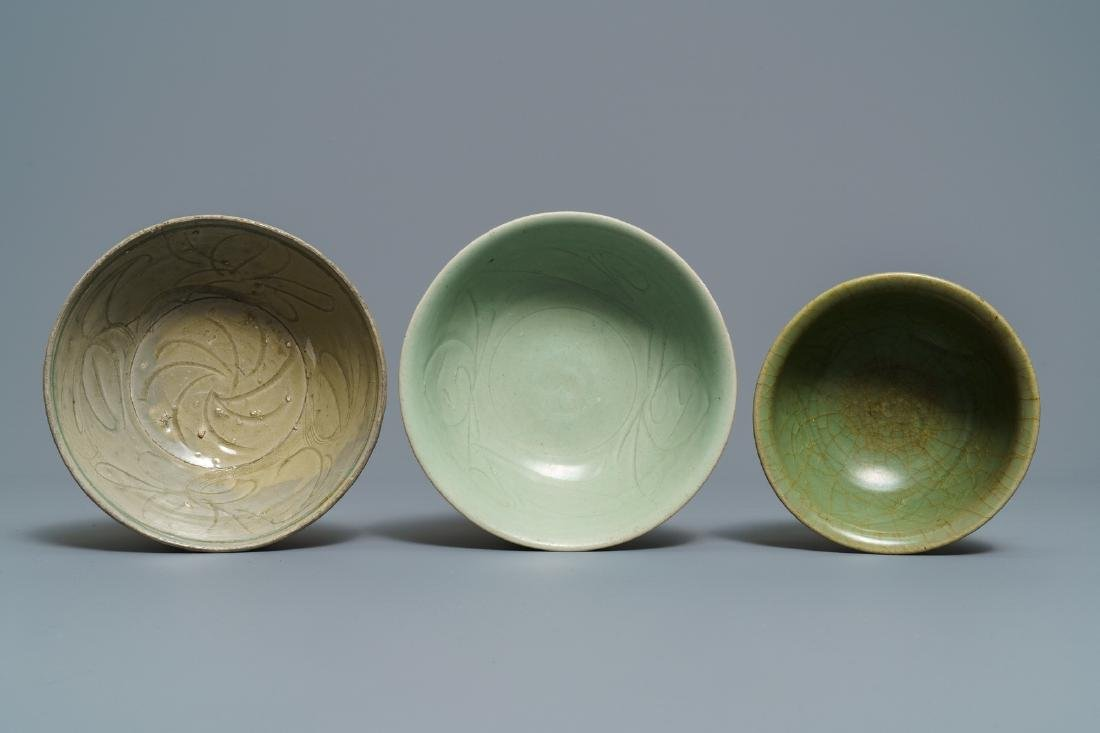 Two Chinese Longquan celadon dishes and three bowls, - 5