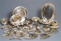 A collection of silver-plated cutlery and tableware,