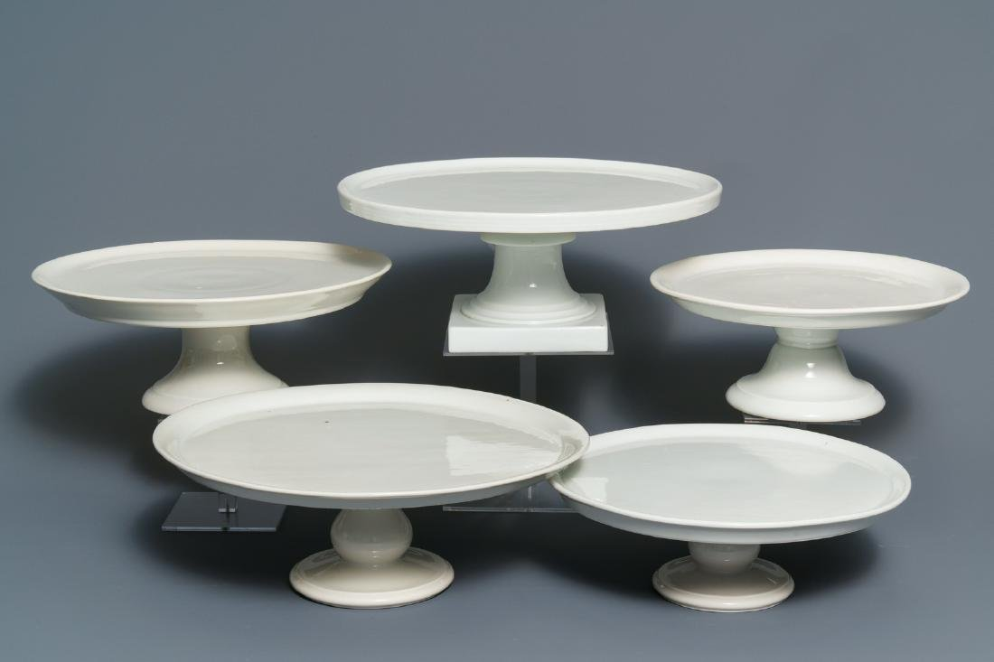 Five large monochrome white French porcelain tazza,