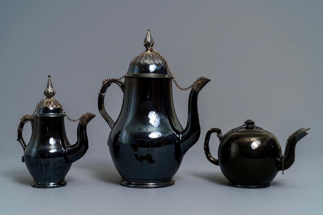 Two silver-mounted Namur black-glazed pottery jugs and