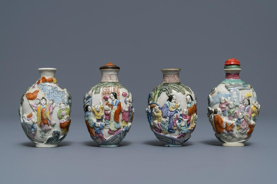 Four Chinese famille rose porcelain relief-decorated
